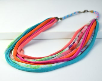 Very colorful ethnic style fabric necklace for women made with strips of jersey fabric, very striking bib necklace unique design