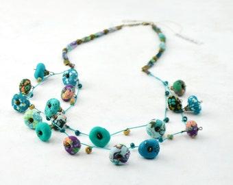 Handmade long necklace turquoise fabric beads, bohemian style eco responsible textile jewelry, designer jewelry Daniela Barbieri