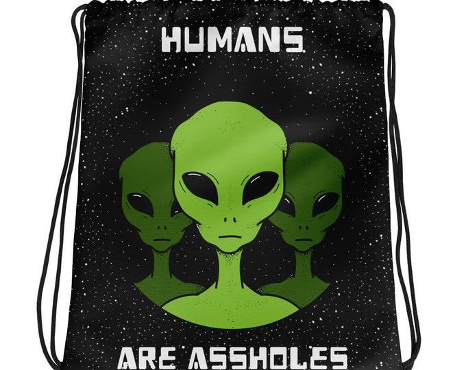 Humans Are Assholes Green Alien Drawstring bag