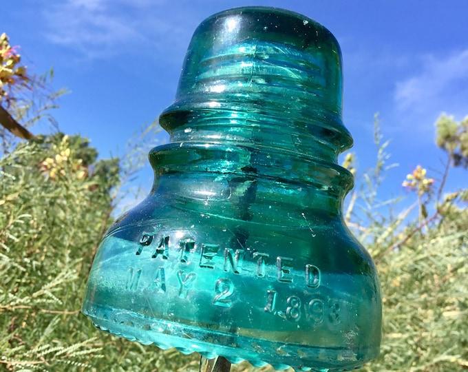 Very weathered glass insulator Hemingray - 40 Green glass antique railroad insulator made from 1910 to 1921 AT&T Telephone insulator