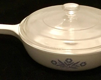 Vintage Corning Ware 6 1/2 inch skillet. Includes lid in great condition. Includes Free Priority Mail Shipping