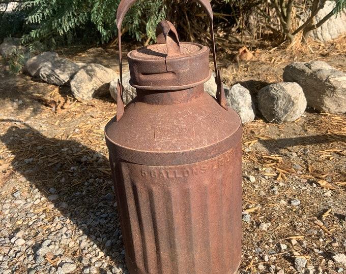 Vintage Ellisco metal 5 gallon antique milk jug. Free shipping