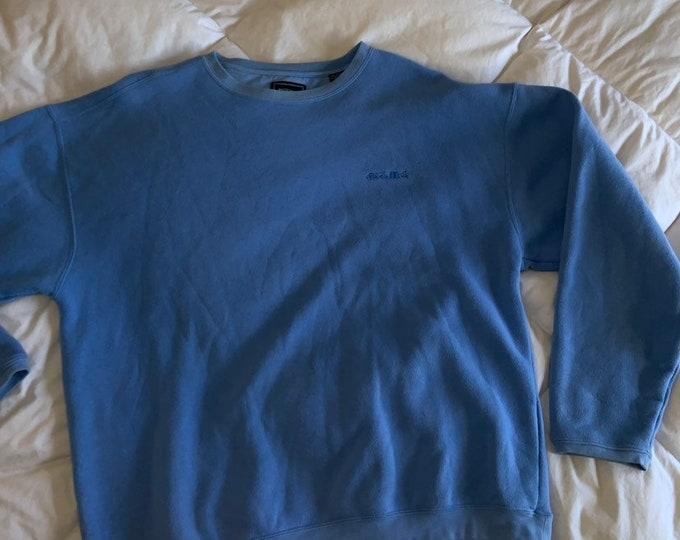 Vintage 1990's bolle Golf crew neck sweatshirt, light blue in size medium. Free shipping