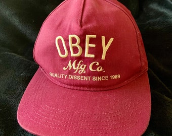 Rare Obey Snap back hat in good vintage condition. Obey Mfg. Co. Quality Dissent Since 1989