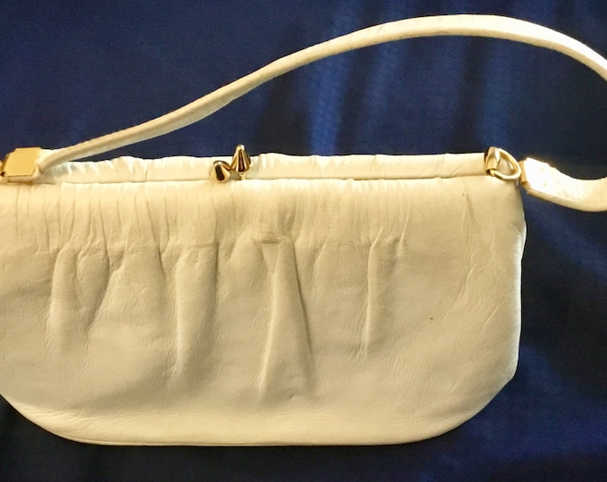 Vintage Etra 1960s clutch or small purse. Super luxury white padded leather in great shape. Free shipping