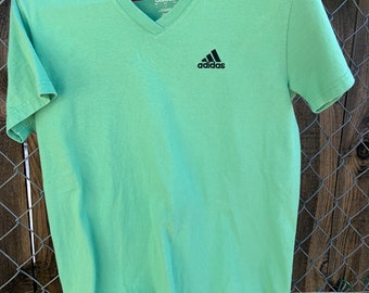Adidas V neck t-shirt Green color fabric in Excellent Condition. Size large. Free shipping
