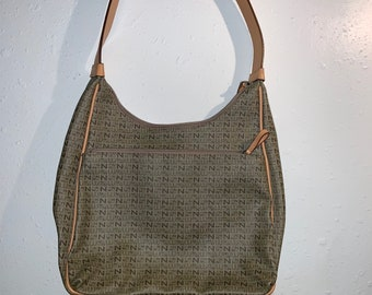 Vintage 1990s Nine West Purse with leather accents in great shape. Free shipping