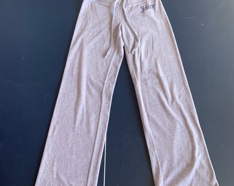 Vintage Juicy Couture soft felt sweat pants in good shape. Size small. Free Priority Mail Shipping in the USA
