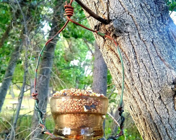 Glass Insulator Bird Feeder Made with Hemingray No 42 and it's original copper wire, great for votive candles and plants too