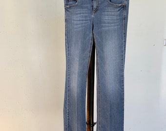 Tommy Hilfiger broken in boot leg jeans in good vintage shape. Free Priority Mail Shipping in the USA