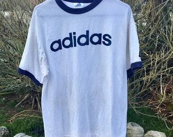 Vintage original Adidas shirt in mens size medium. In good vintage shape. Free shipping