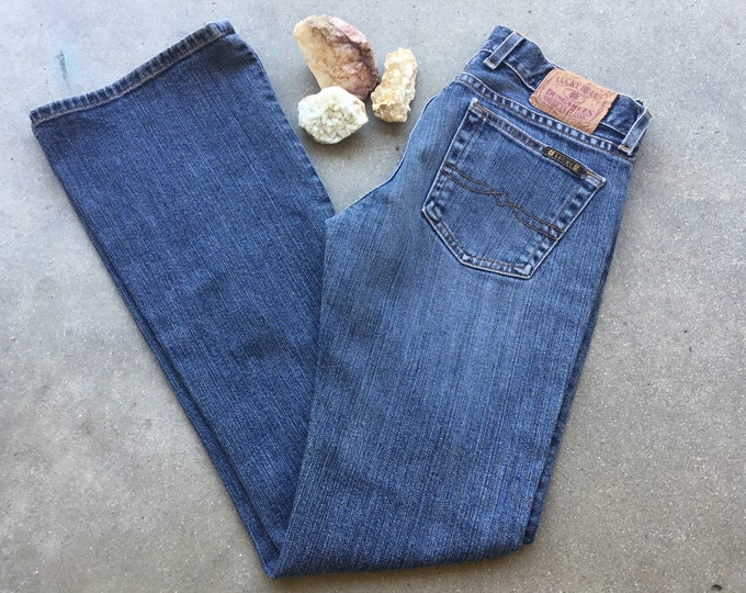 Woman's  Lucky Brand Dungarees Jeans, Very cute and curvy. Size 0. Free Priority Mail Shipping in the USA