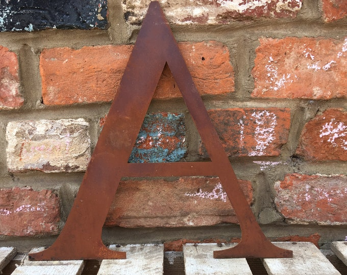A Rusty metal letters, shop signage, initials, house sign garden name, lettering, rusted, industrial, vintage, numbers barbers, home, love,