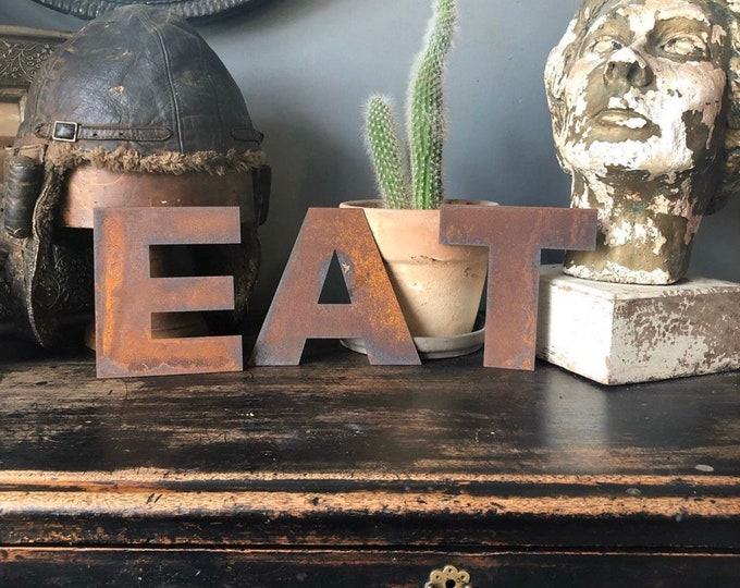 EAT SIGN , Kitchen sign , rusty metal letters.