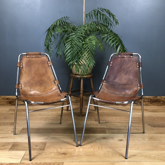 Pair Of Mid Century Charlotte Perriand Les Arcs Chairs Leather Chrome Seating
