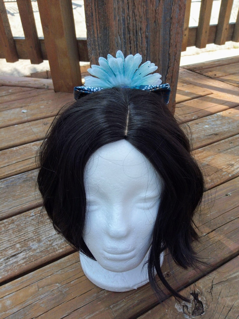 Blue Speckled White Flower On A Floral Blue Bow
