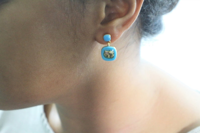 Momoberry Sanrio Hello Kitty Gold Pierced Earrings with Black Gemstone