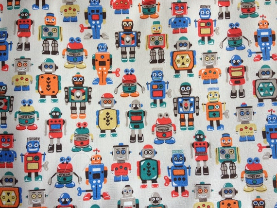 Red and white Robots Poly//cotton  fabric price per metre