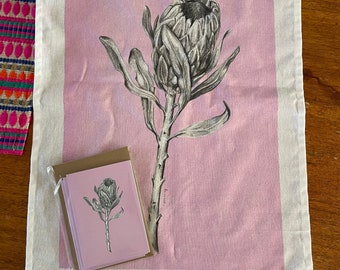 Protea art pink tea towel & pink card set. Floral graphite drawing artwork on 100% cotton and matching card. Kitchen linen or unique gift.
