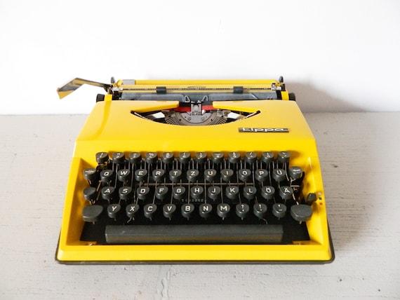 60s typewriter triumph/Triumph Tippa Yellow/typewriter Yellow/1960 typewriter