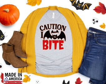 "Funny Shirt, ""Caution I Bite"" Bat Funny Shirt, Cute Fall Shirts, Women's Graphic Tee, Halloween Shirt, Thanksgiving Shirt, Pumpkin Spice"