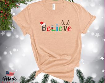 Christmas Believe TShirts, V-Necks, Gerber Onesies & more! Graphic Tee,  Believe Shirt, Classic Christmas