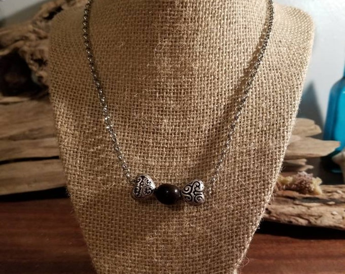Seabean with silver colored hearts