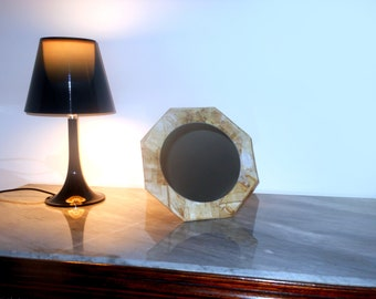 Octagonal mirror with tea sachets