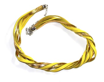 Torchon neckline with strands of gold and yellow leather