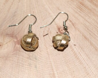 Gold leather pearl dangling earrings