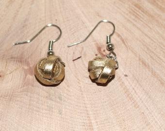 Gold leather pearl dangling earrings