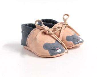 Painted leather baby baboons, laced at the ankle