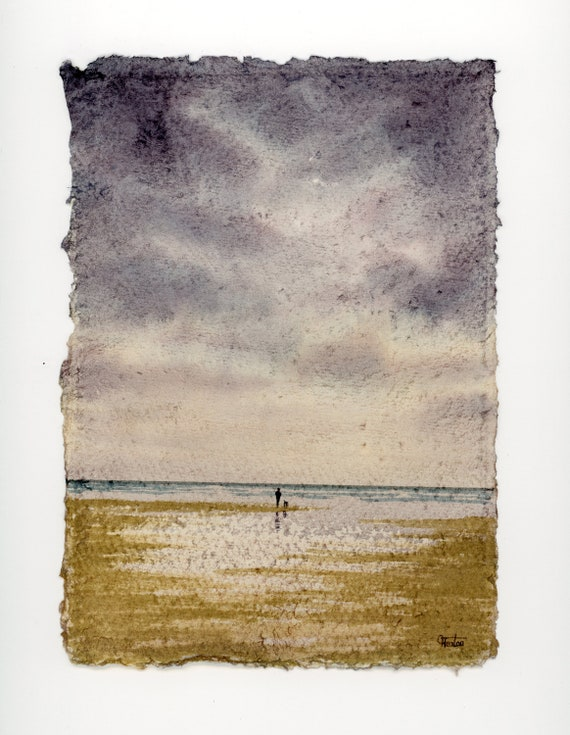 """Original 12"""" x 10"""" mounted deckled edged watercolour beach painting on handmade 100% cotton rag paper. Figure and dog in storm. Art from UK"""