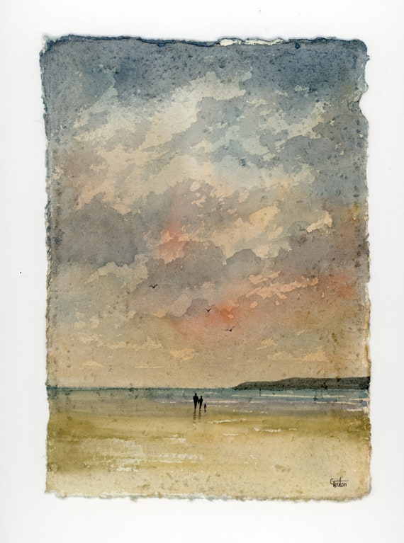 """Original 12"""" x 10"""" mounted deckled edged watercolour beach painting on handmade 100% cotton rag paper. Couple and dog in storm. Art from UK"""