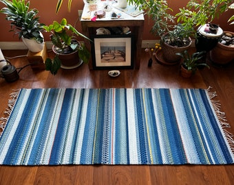 Handwoven wool rug using all natural indigo dyes. For meditation, sacred space, small area rug or as a wall hanging. Made in LA home studio.