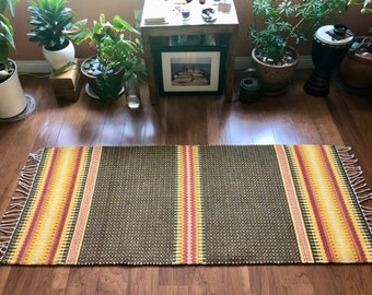 Handwoven rug using all natural dyes. For meditation, prayer, sacred space, small area rug or as a wall hanging. Made in LA home studio.