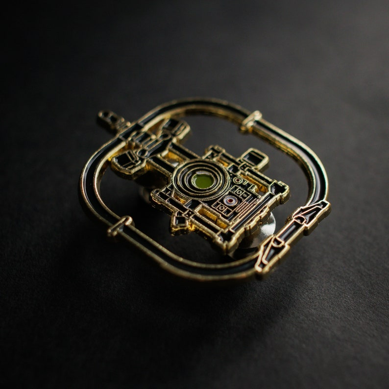 Movie Camera Stabilizer enamel pin. Great for filmmakers image 0