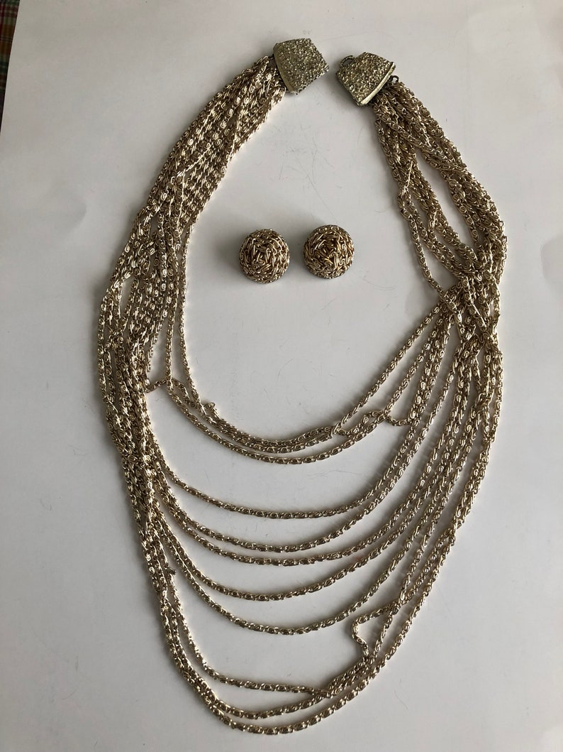 Vintage Gold Multi-strand Waterfall Necklace and matching Clip on Earrings21 12 Earrings are 1 RoundGreat Condition#VB40