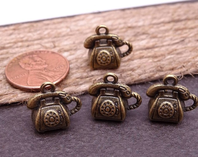 12 pc Telephone, telephone charm, phone, phone charm. Alloy charm, very high quality.Perfect for jewery making and other DIY projects, box15