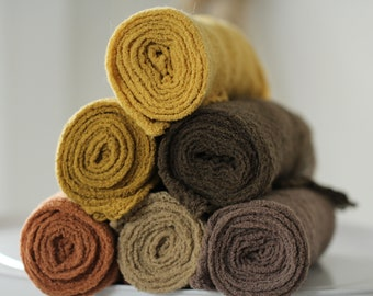Gots certified cotton wrap made of cotton gauze earth tones and yellow tones