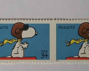 2 Snoopy Peanuts Stamps Unused