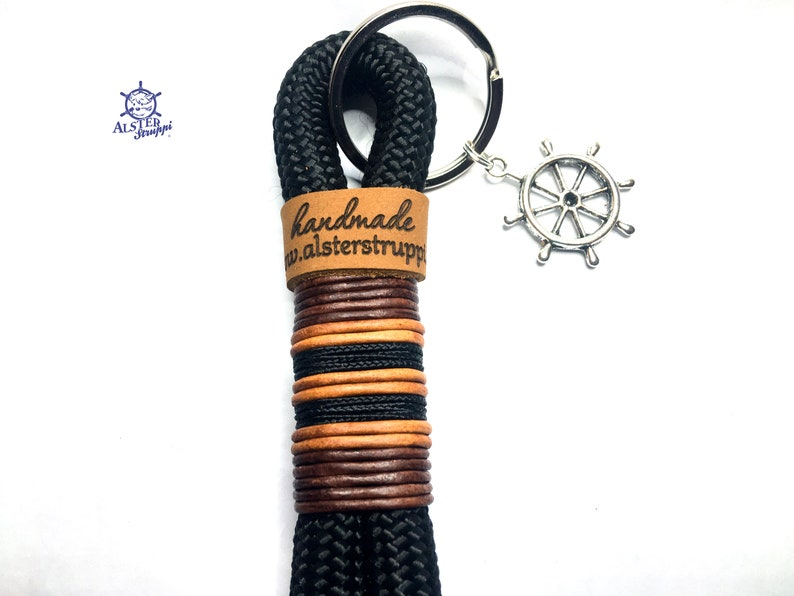 Keychain handmade by the brand AlsterStruppi in black with leather and black tacter personalized is possible