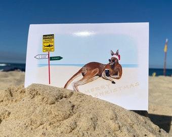 Christmas Card, Kangaroo on beach with Irish County Sign & Guinness, Merry Christmas, Australia to Ireland, Irish Card, Sunbathing Kangaroo