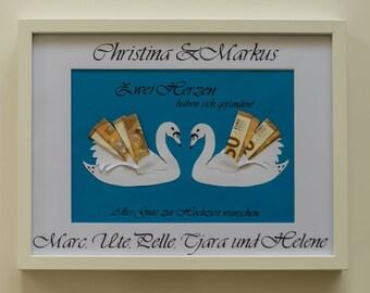 Money gift swans in frame