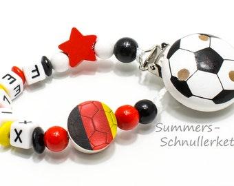 Schnullerkette Fußball, schwarz, rot, gold