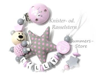 Schnullerkette mit Namen,  kleine Schwester, Bär, Knister-od. Rasselstern, grau-rosa