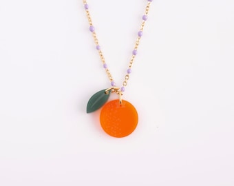 Short purple pearl necklace with orange and acrylic sheet