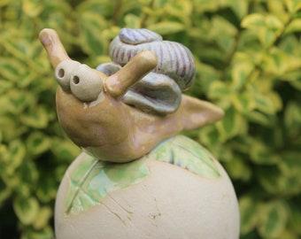 Garden ball with snail, garden decoration, garden ceramics