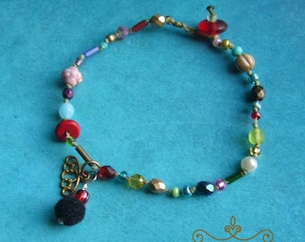 Boho bracelets, glass beads, knotted, arm jewelry, gift for woman, colorful, yoga jewelry, filigree pendant, pompom pendant