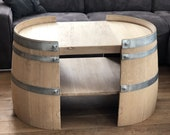 Short coffee table made of wine barrel halves natural